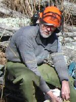 Wil Kohlbrenner taking a break from work on the trail
