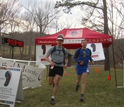 Joe Clapper and Greg Loomis finishing Bel Monte 50 Mile